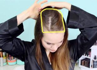 Верхняя часть волос, зафиксированная зажимом