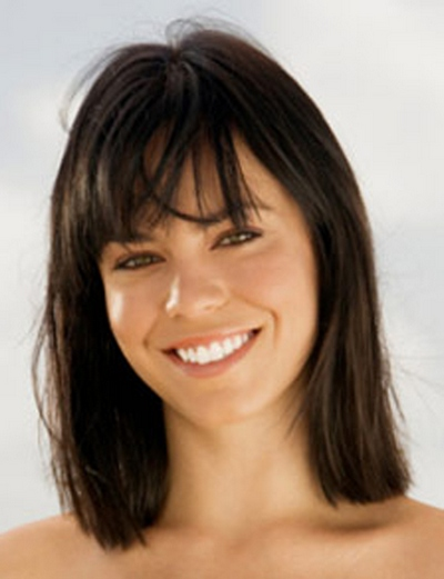 Portrait of a young woman smiling on the beach
